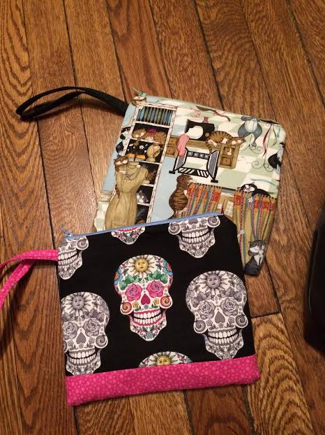 skull and cat pouches